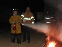 Explorer extinguishing fire during training exercise